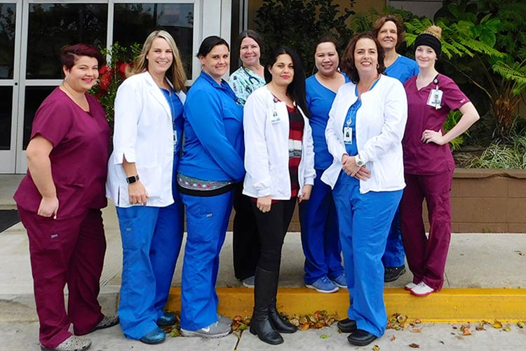 ccc staff in front of Comprehensive Care Center