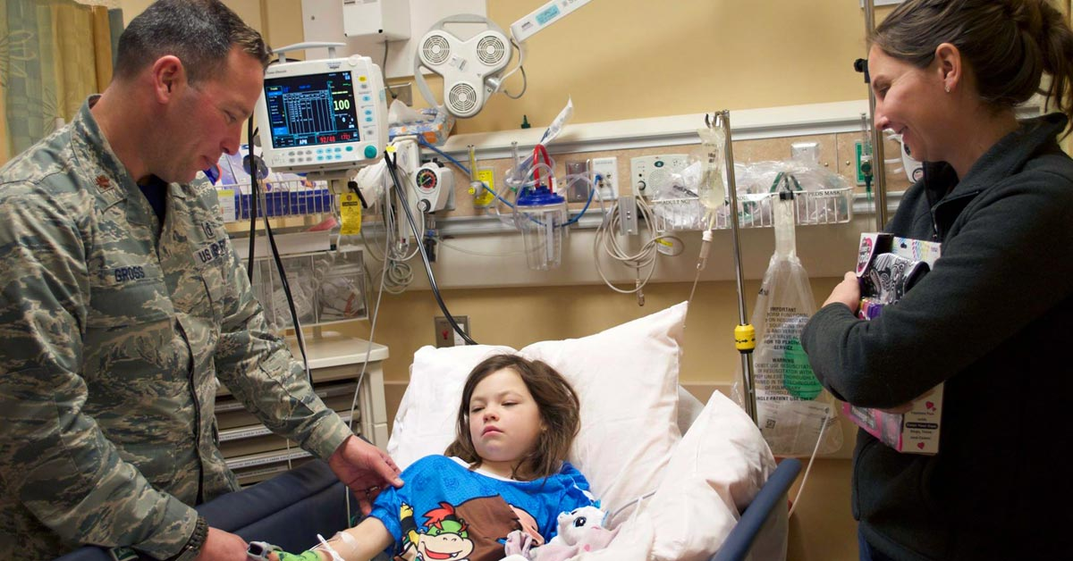Child in hospital bed and Family