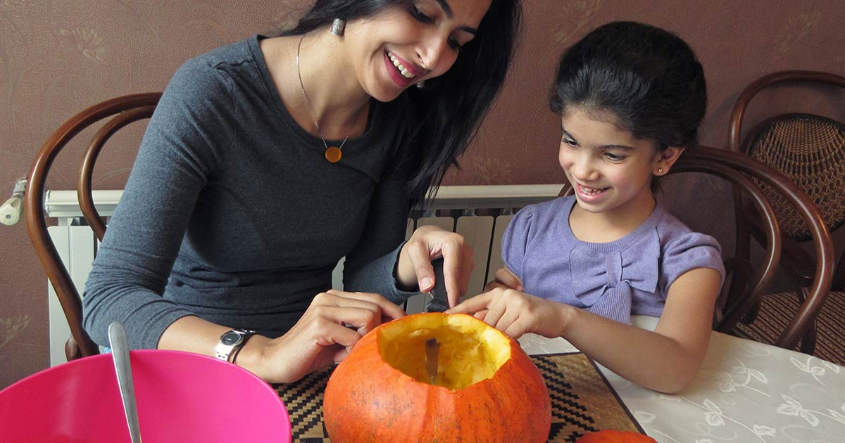 mother and child carving pumpkin