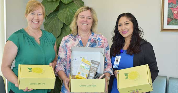 LVMC staff holding gift boxes