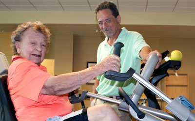 Bev Walter in Physical Therapy with David Munar