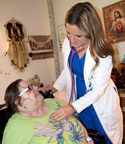 Karen Vordale caring for an elderly patient
