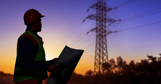 safety inspector reviewing power lines