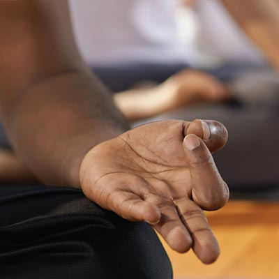 person meditating in yoga class