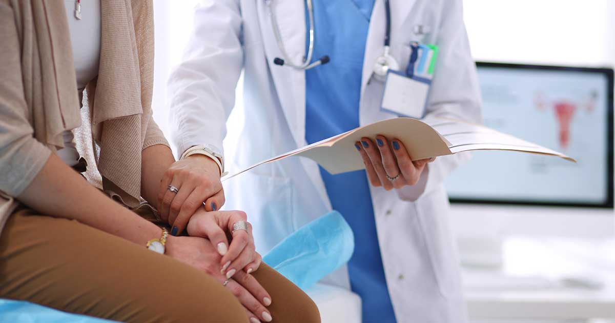 doctor offering female patient emotional support