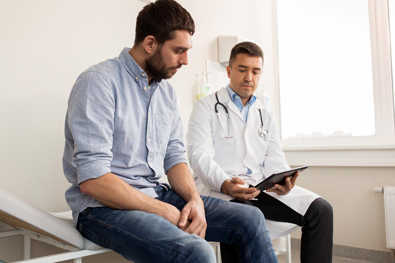 male patient speaking with doctor