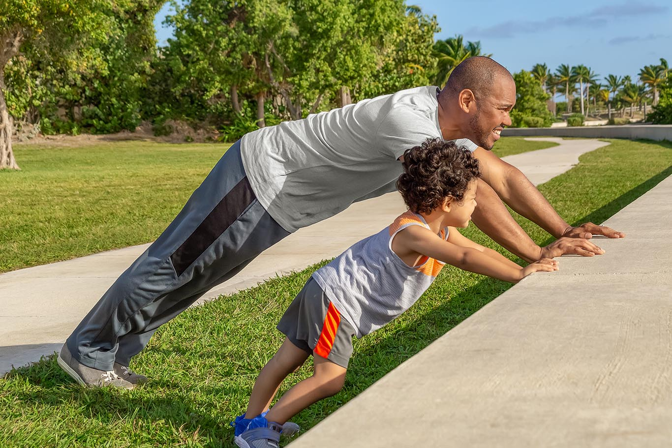 man exercising with his child